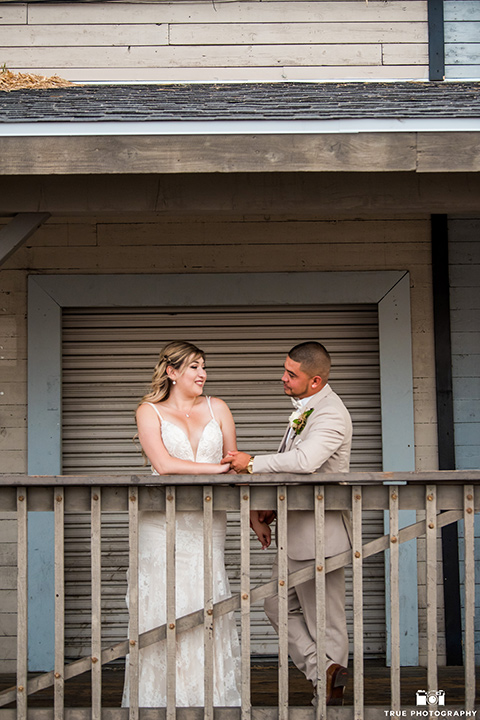 Fiesta Hall Wedding bride and groom stand under awning
