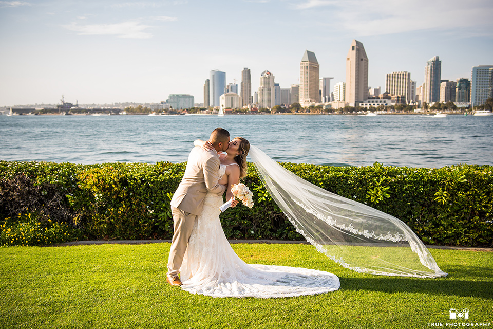 groom dipping the bride after a wedding in San Diego