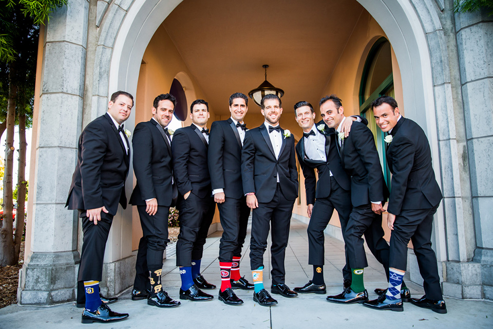 Admiral Kidd Club groomsmen and socks groomsmen in black tuxedos groom in a traditional black tuxedo