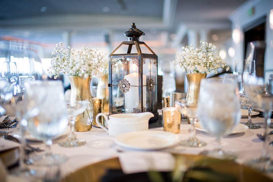 Admiral Kidd Club table setting with white décor with black and gold accents