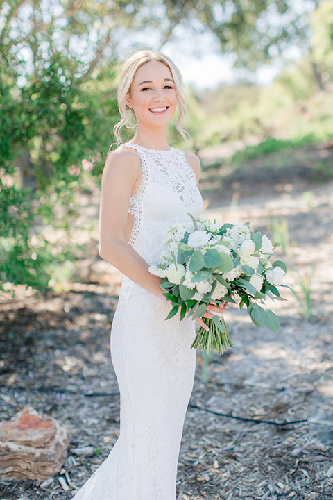 Arroyo-Grande-Wedding-bride-with-flowers-in-a-bohemian-style-gown-with-a-high-neckline-anda-open-back