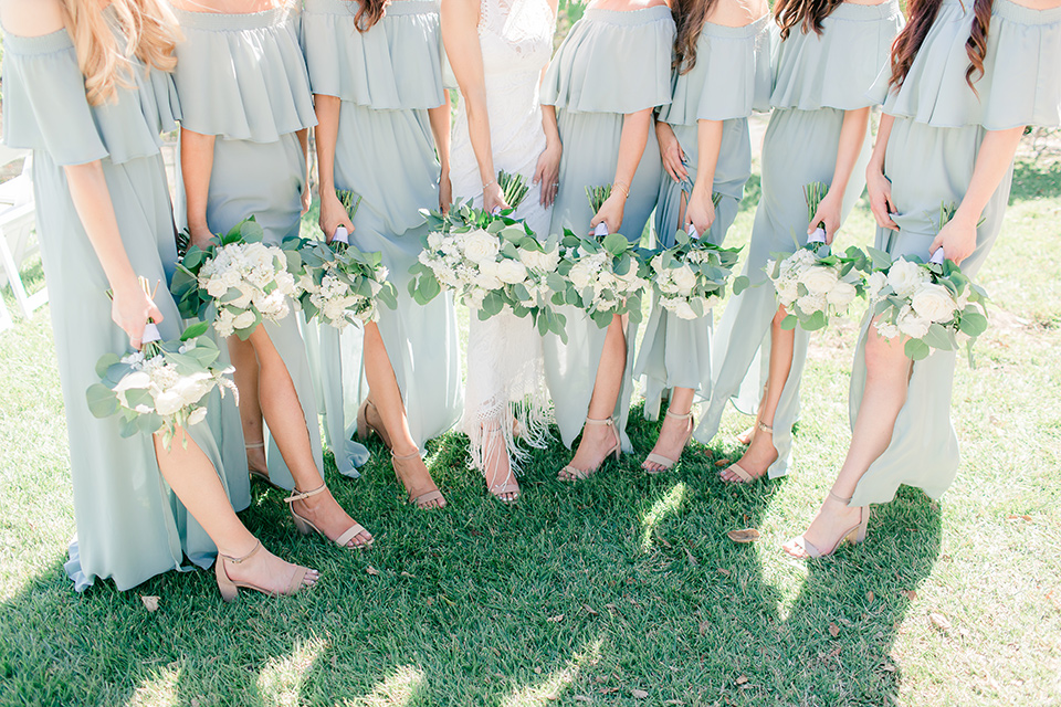 Arroyo-Grande-Wedding-bridesmaids-in-light-sage-gowns-and-beige-strapy-heels