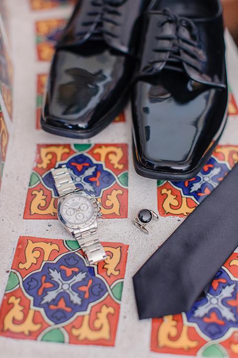 Arroyo-Grande-Wedding-groom-accessories-with-black-tuxedo-shoes-and-a-black-tie