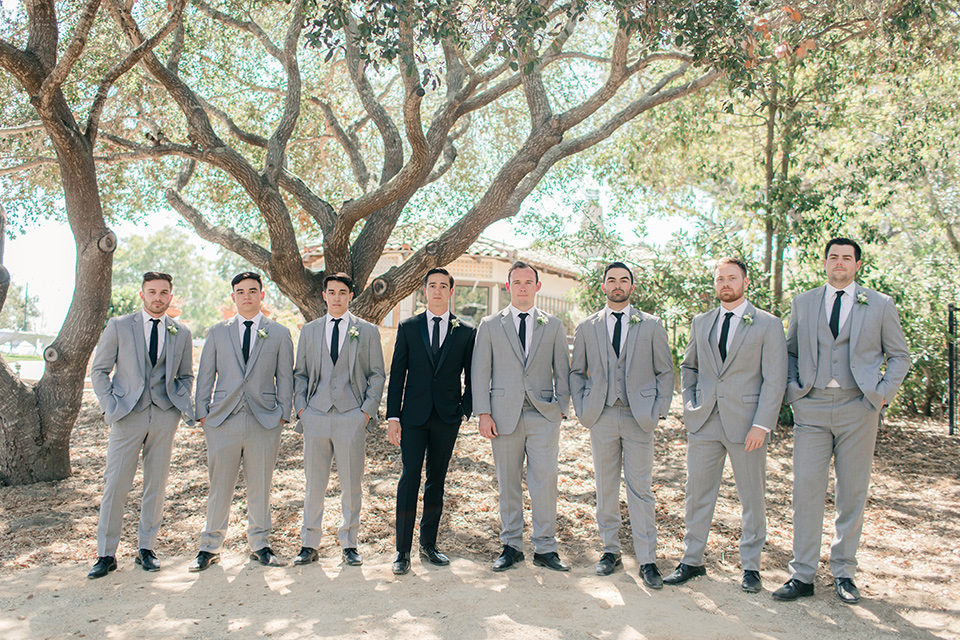 Arroyo-Grande-Wedding-groom-and-groomsmen-the-groom-wore-a-traditional-black-tuxedo-and-black-long-tie-while-the-groomsmen-wore-light-grey-suits