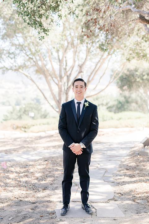 Arroyo-Grande-Wedding-groom-in-a-traditional-black-tuxedo-and-black-long-tie