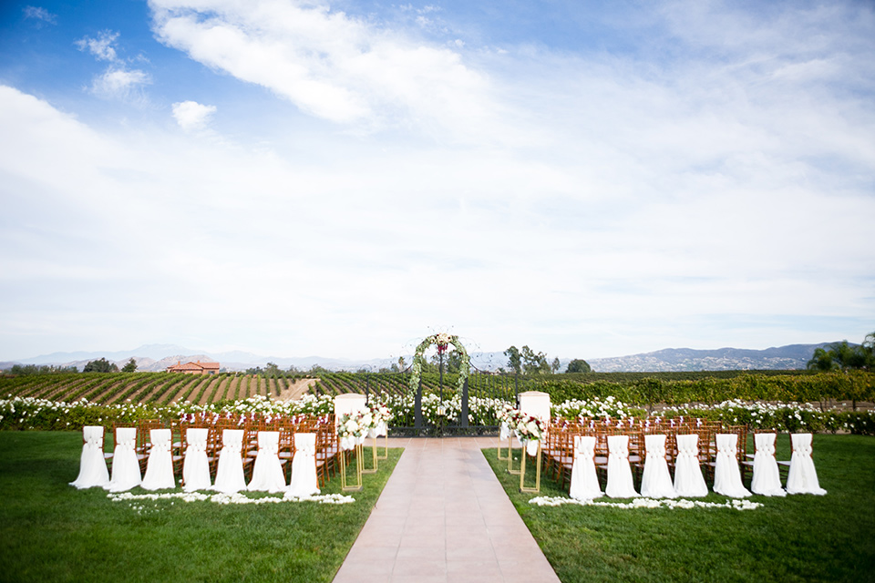 Villa de Amore wedding ceremony space with white chairs and flowing white linens