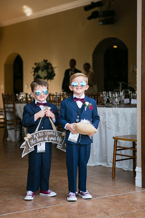ring bearers wearing little dark blue suits and wearing sunglasses
