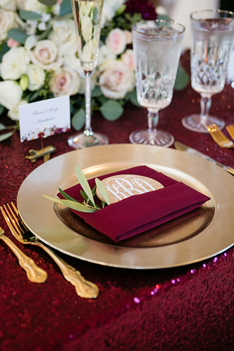 temecula weding table decor with burgundy linens and gold flatware