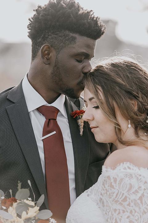 coronado-yacht-club-wedding-groom-kissing-brides-head