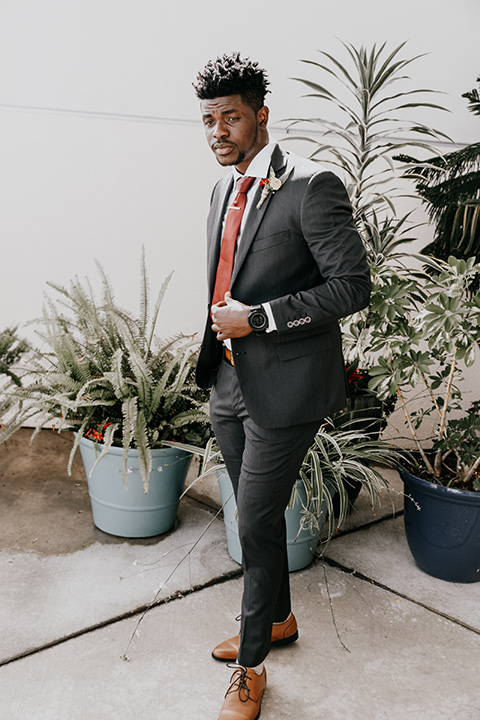 coronado-yacht-club-wedding-groom-standing-in-a-charcoal-suit-with-a-red-tie
