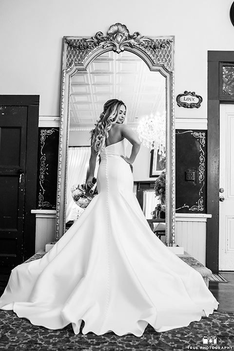 twin-oaks-weddings-bride-standing-in-a-strapless-fit-and-flare-gown-with-a-sweetheart-neckline