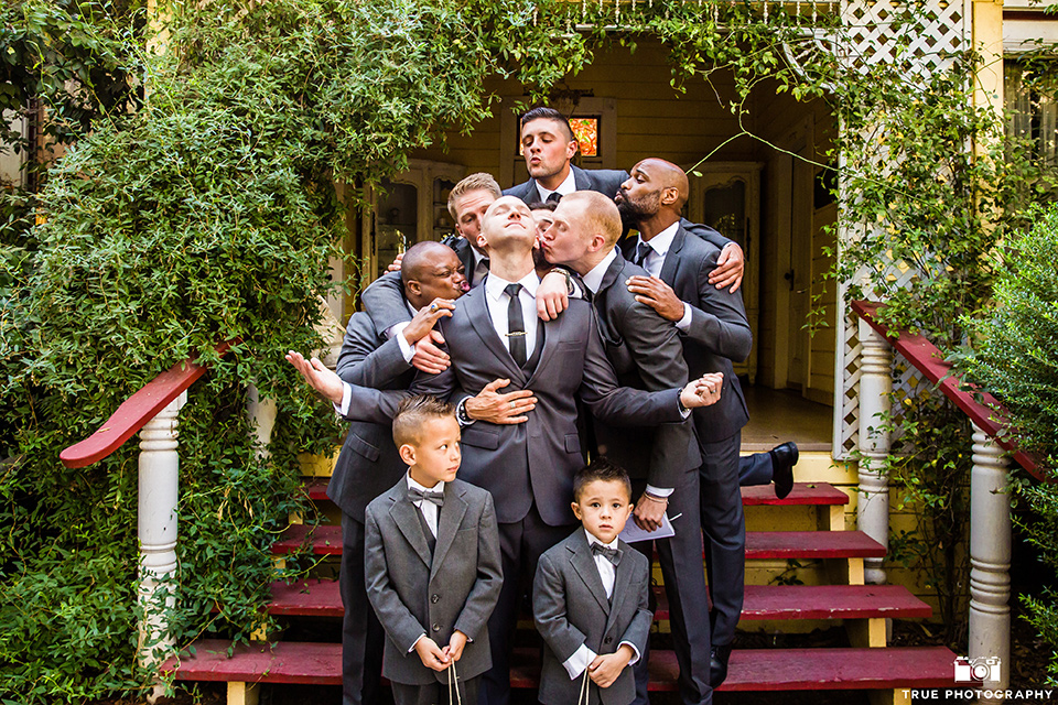 twin-oaks-weddings-groomsmen-pretending-to-kiss-groom