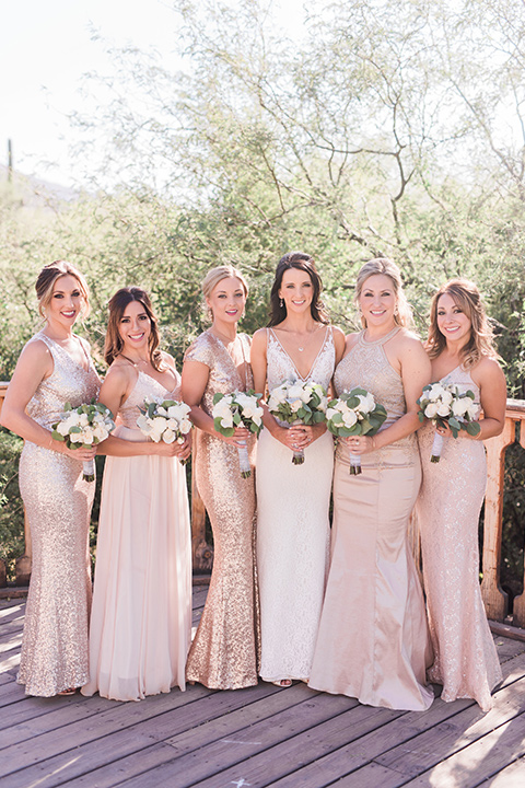 tanque-verde-ranch-arizona-wedding-bridesmaids-bride-in-a-white-formfitting-gown-bridesmaids-in-blush-toned-gowns
