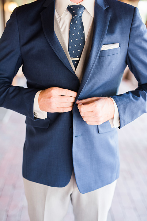 tanque-verde-ranch-arizona-wedding-close-up-on-groom-in-grey-pants-and-a-blue-suit-coat