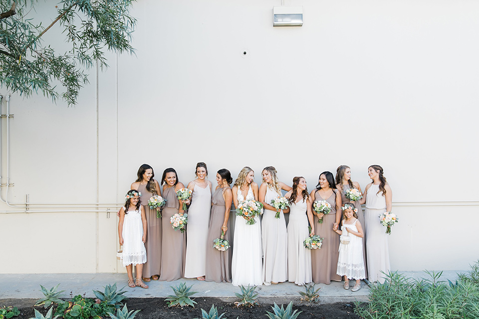 callaway-winery-wedding-bridesmaids-bride-in-a-flowing-white-gown-with-straps-and-a-deep-v-neckline-bridesmaids-in-taupe-and-nude-gowns