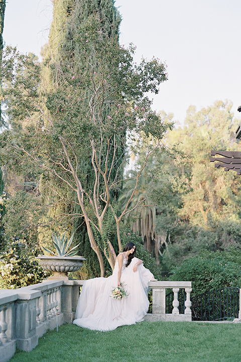 Kimberly-crest-house-shoot-bride-sitting-in-a-modern-princess-inspired-flowing-white-gown-with-a-full-skirt