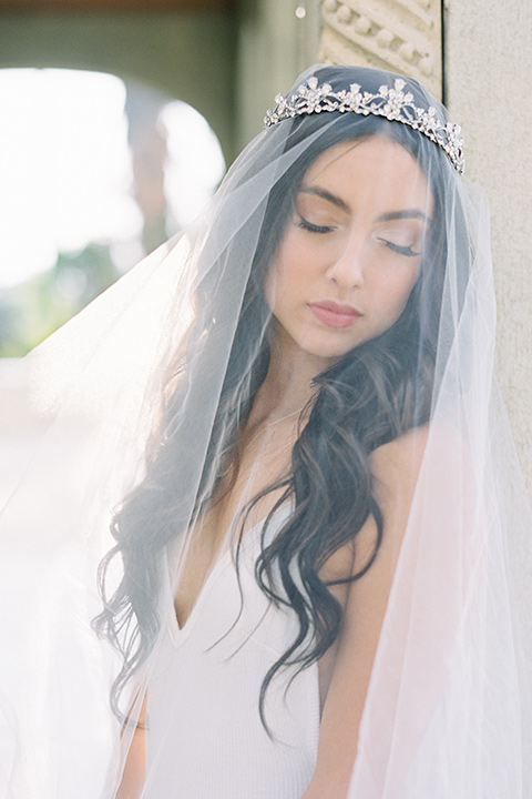 Kimberly-crest-house-shoot-bride-with-veil-in-a-flowing-white-gown-with-a-full-skirt