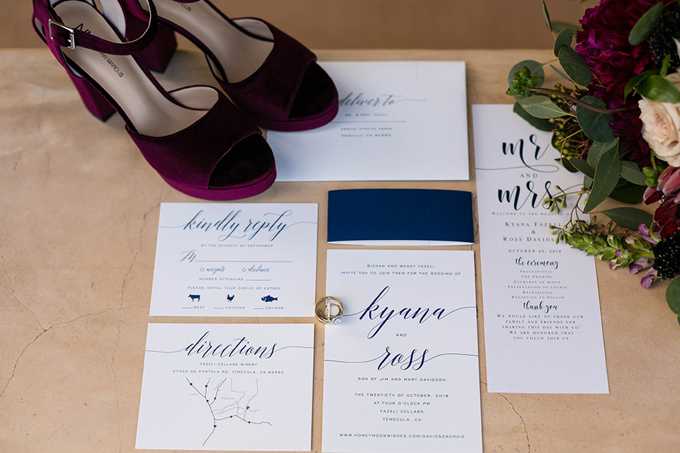 white invitations with burgundy velvet heels and green calligraphy