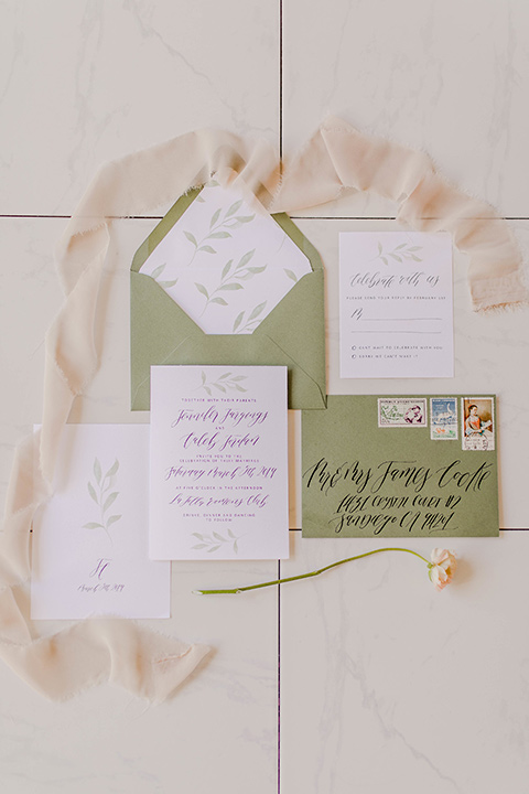 white invitations with sage green envelopes