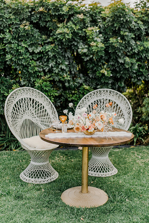 white wicker chairs with wooden table