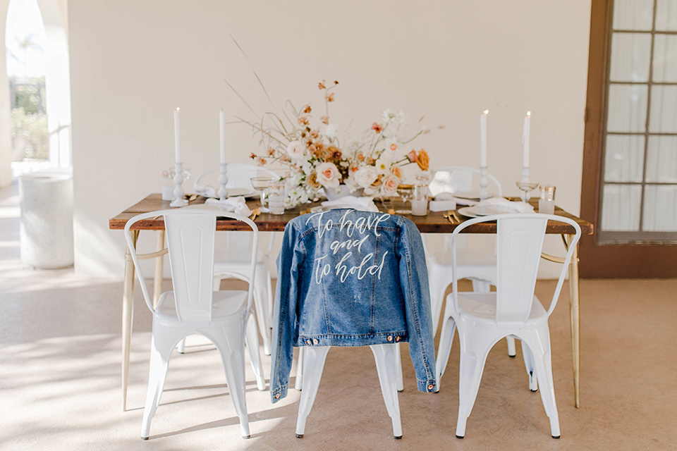 wooden tables with white farm chairs and details