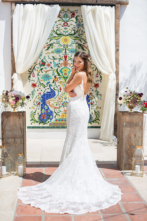bride in a white gown with thin straps and lace detailing