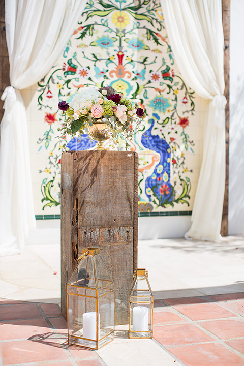 wooden ceremony décor with colorful tile wall