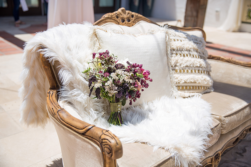 white vintage couch with white fur throw blanket