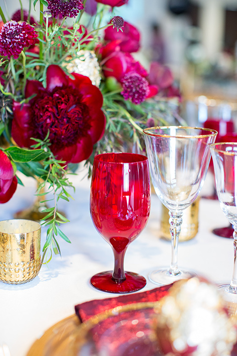 red and gold table décor and flatware