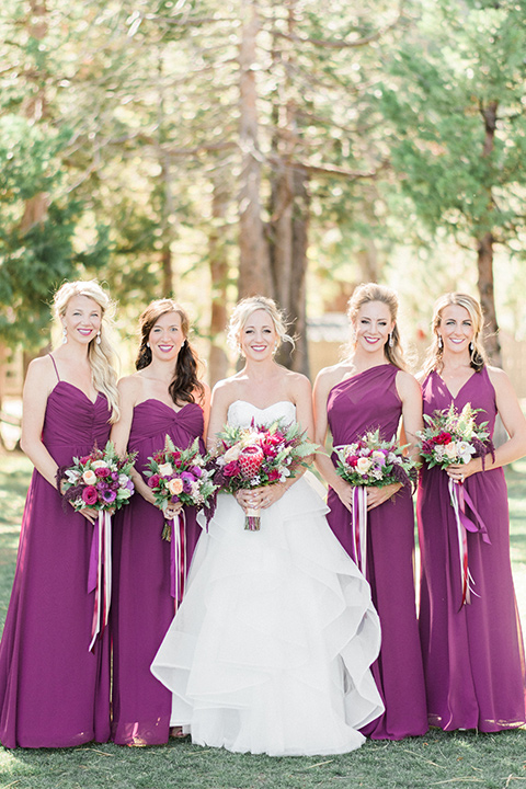 The bride and bridesmaids pose for a photo
