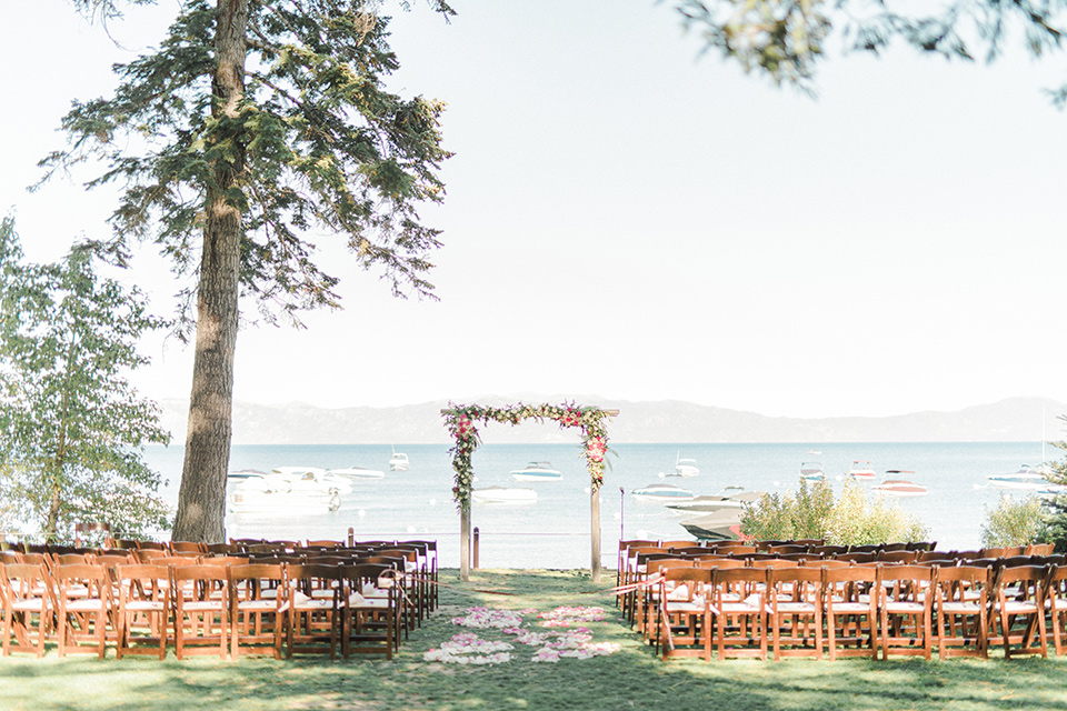Lake Tahoe wedding ceremony space with wooden chairs and ceremony arch