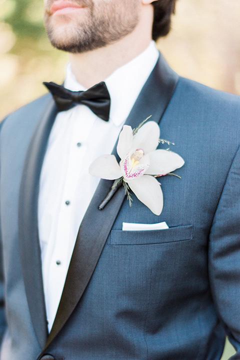 Close up of the groom's notch lapel suit