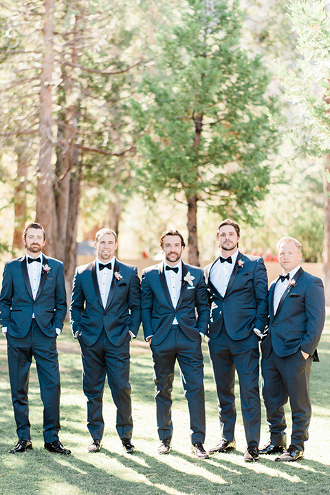 The groomsmen pose for a wedding photo