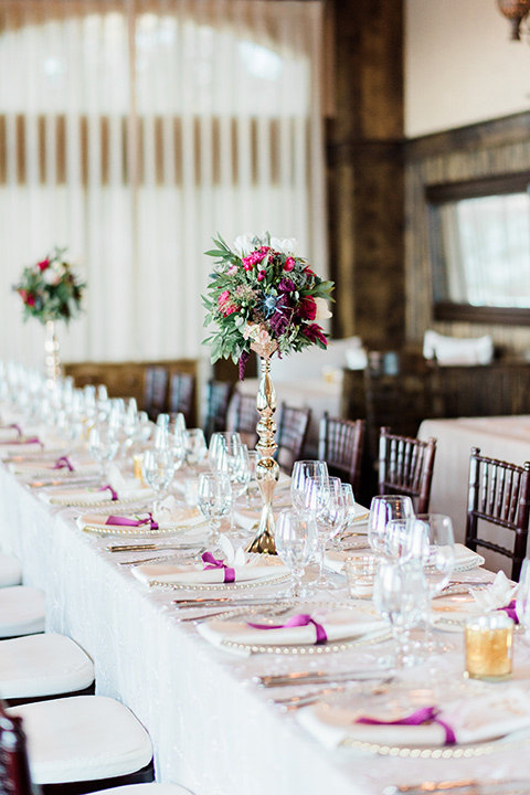 Lake Tahoe wedding table décor with white linens and gold flatware
