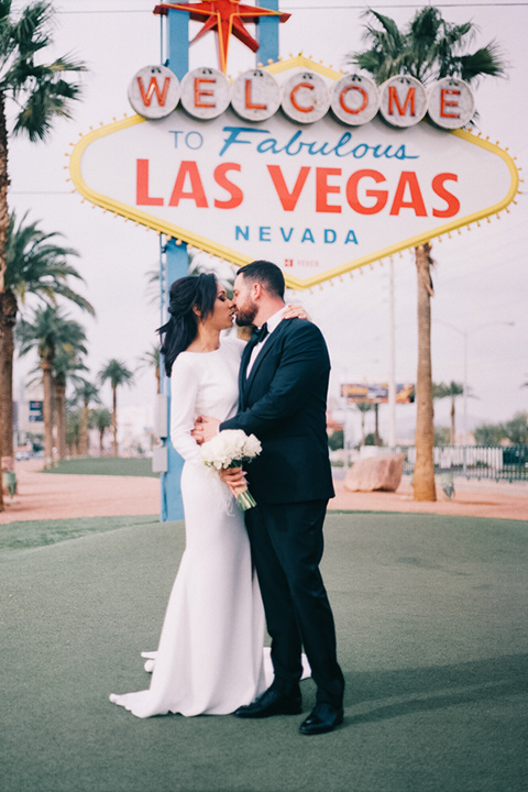 Couple pose for engagement photo in front of Las Vegas sign