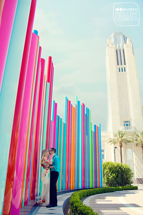 couple pose for engagement photo at symphony park