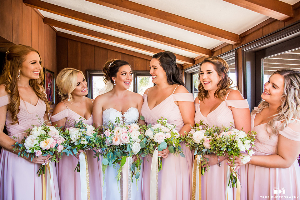 mount-woodson-castle-bridesmaids-in-light-pink-long-dresses-bride-in-a-mermaid-gown-with-lace-detailing-and-a-sweetheart-neckline