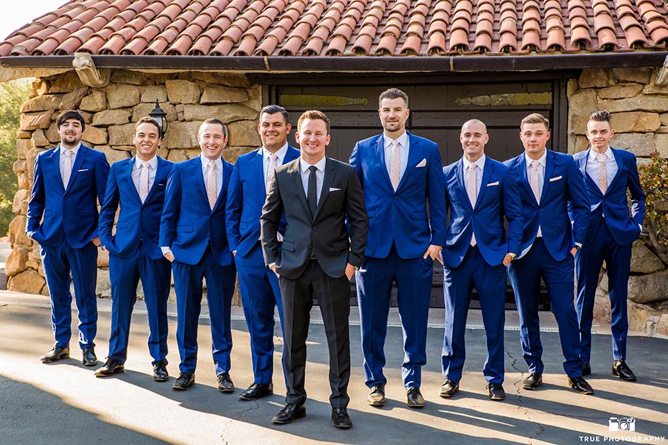 mount-woodson-castle-groomsmen-in-cobalt-suits-groom-in-a-black-suit