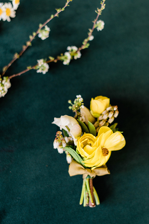 malibu-lodge-spring-wedding-shoot-boutionnere-with-a-yellow-flower