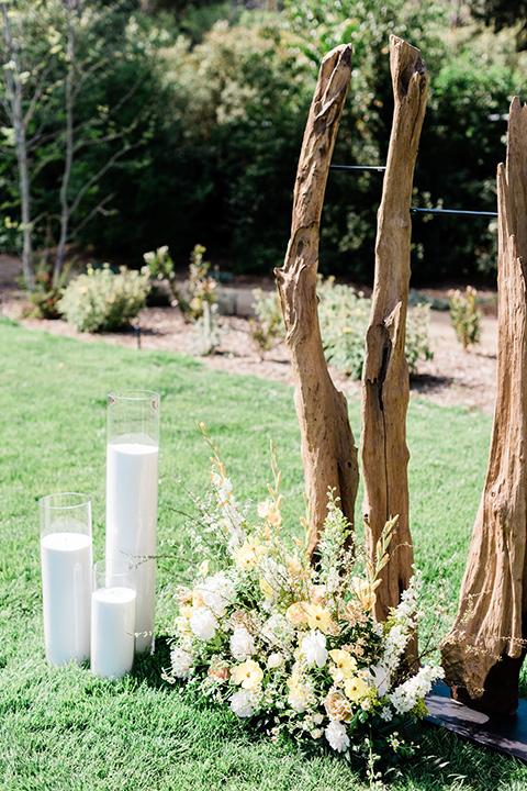 malibu-lodge-spring-wedding-shoot-candle-decor-at-ceremony