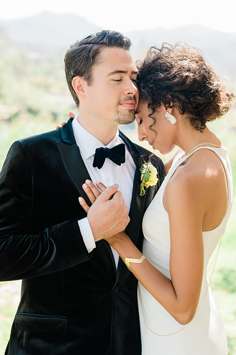 malibu-lodge-spring-wedding-shoot-close-up-of-couple-bride-in-a-high-neckline-dress-groom-in-a-black-velvet-tuxedo