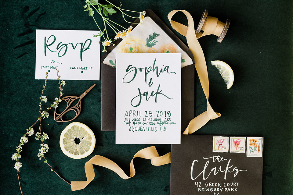 malibu-lodge-spring-wedding-shoot-invitations-with-white-paper-and-yellow-and-green-calligraphy