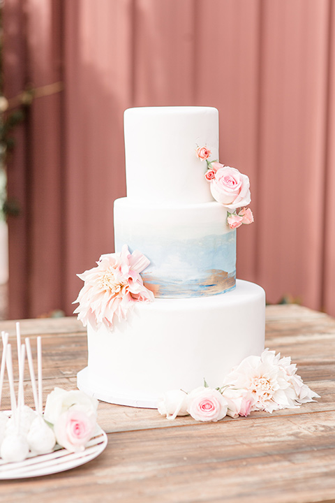 Lorimar-winery-shoot-a-three-teir-cake-with-white-fondant-and-blue-and-blush-details