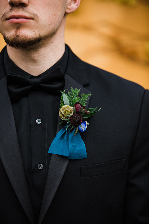 Los Robles Greens Shoot close up on groom in an all black tuxedo look with a black shirt and bow