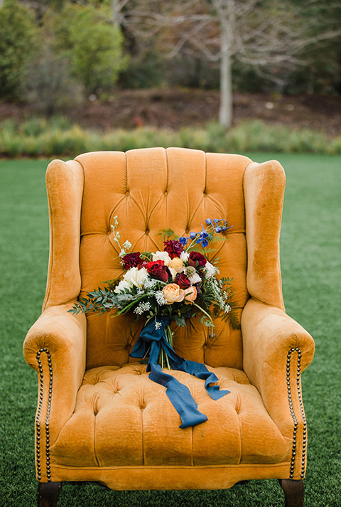 Los Robles Greens Shoot florals in chair with a velvet mustard yellow chair