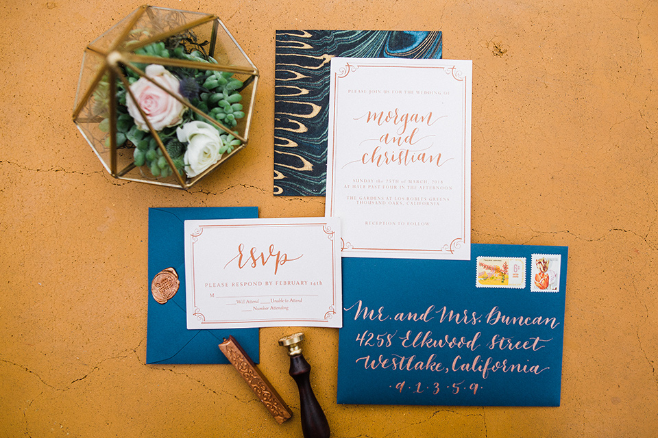 Los Robles Greens Shoot invitations with blue envelopes and yellow writing