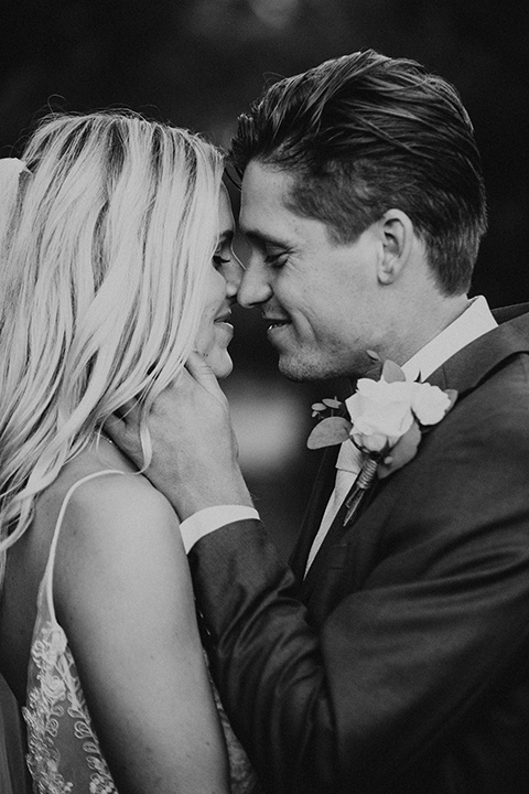 monarch-beach-resort-black-and-white-photo-close-up-of-bride-and-groom-bride-in-a-lace-dress-with-thin-straps-groom-in-a-grey-suit-with-ivory-long-tie
