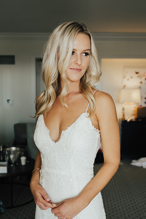 monarch-beach-resort-bride-alone-bride-and-groom-bride-in-a-lace-dress-with-thin-straps-groom-in-a-grey-suit-with-ivory-long-tie