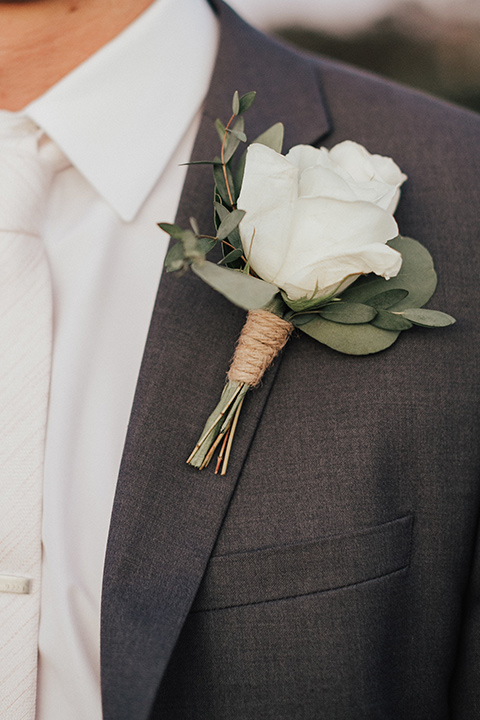 monarch-beach-resort-close-up-on-jacket-groom-in-a-grey-suit-with-ivory-long-tie
