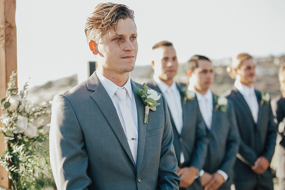 monarch-beach-resort-groom-at-ceremony-groom-in-a-grey-suit-with-ivory-long-tie